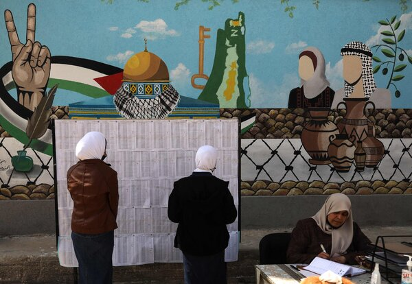 Palestinian voters searching for their names on the electoral roll at a school in Gaza City.