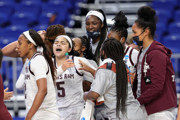 Jordan Nixon (No. 5) was mobbed by her teammates after she hit a winning layup to send Texas A&M to the Sweet 16.