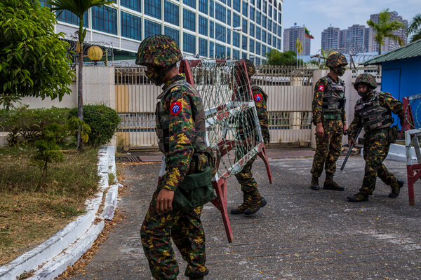 Soldiers setting up barricades in Yangon, Myanmar, this month as tens of thousands of people gathered to protest the coup that ousted the civilian government.