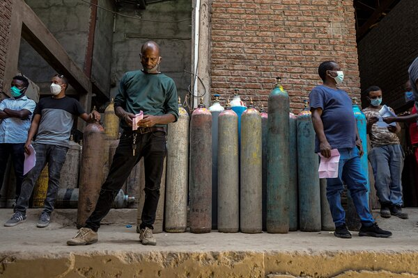 Waiting to fill oxygen cylinders at a facility in Addis Ababa, Ethiopia, last week.
