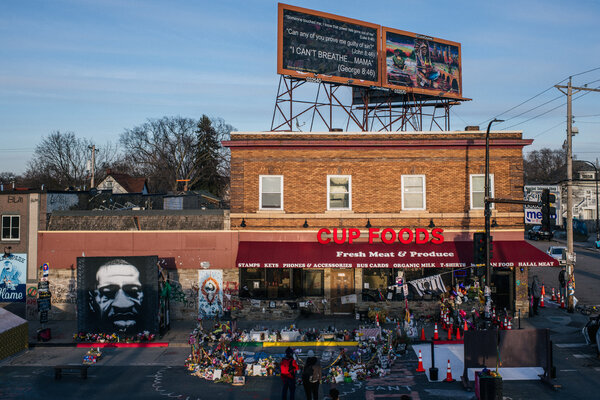 A candlelight vigil was held Sunday at the intersection of 38th Street and Chicago Avenue in Minneapolis, where George Floyd was killed in May.