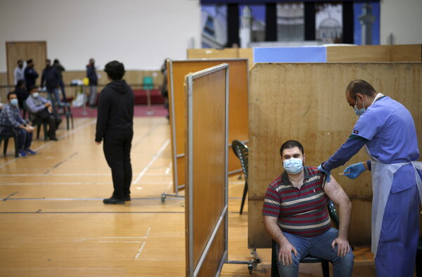 A vaccination centre at a mosque in London, on Sunday. Britain has given over 30 million vaccine doses.