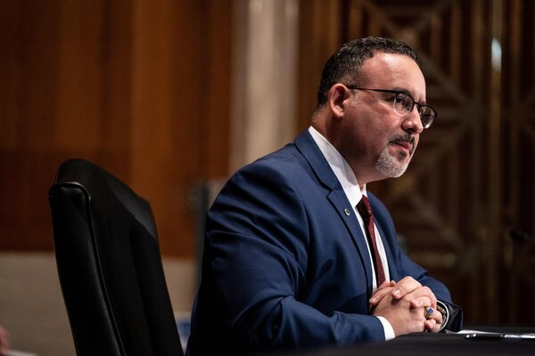 """Education Secretary Miguel Cardona said Tuesday his goal is to help borrowers who are in default """"get the same protections previously made available to tens of millions of other borrowers."""""""