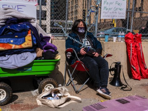 Kaia Hirt has chained herself to the barricade surrounding the Hennepin County Government Center.