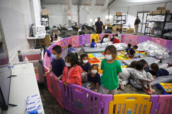 Young children were being cared for by older siblings in a playpen area in the border processing facility in Donna, Texas.