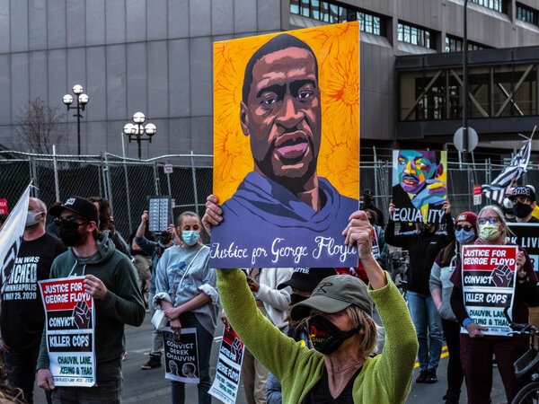 Hundreds gathered at a Minneapolis rally for George Floyd after the first day of the Derek Chauvin trial.