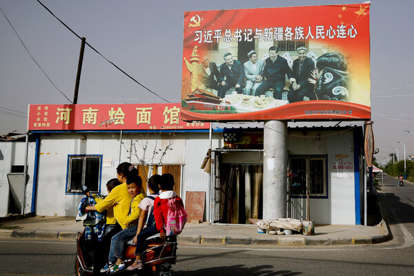 A propaganda picture in the Xinjiang city of Hotan in 2018 that shows China's top leader, Xi Jinping, with Uyghur elders.