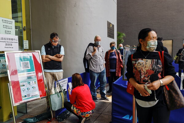 Lining up at a vaccination center in Hong Kong last week. Only 6 percent of the city's 7.5 million people have received a first dose so far.