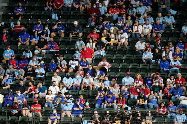 Fans watching the Milwaukee Brewers play the Texas Rangers in a preseason baseball game at Globe Life Field in Arlington, Texas, on Monday.