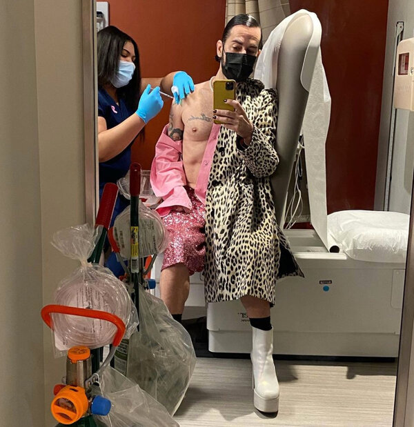 The designer Marc Jacobs taking a selfie as he received a Covid-19 vaccine.
