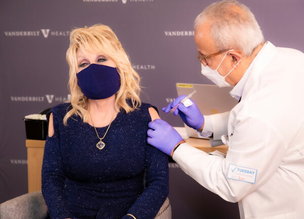 Dolly Parton receiving a vaccine dose last month in Nashville.