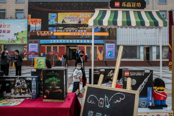 Several businesses in China are offering incentives for those getting inoculated, including this Lego stall outside a vaccination center in Beijing.