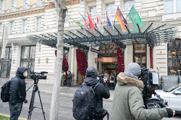 Journalists waited outside the Vienna hotel where closed-door talks over Iran's nuclear program were taking place on Tuesday.