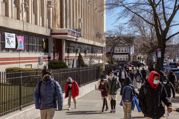 Students exiting a school in Queens, N.Y., amid the pandemic in March.