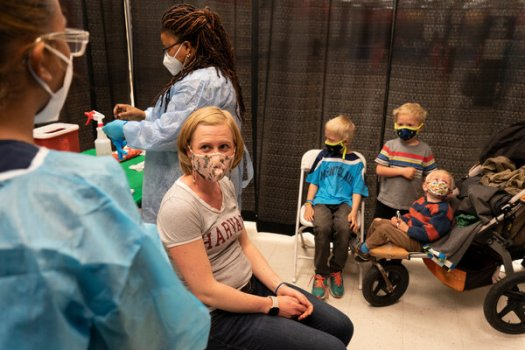 A former Kmart in West Orange, N.J., is now a coronavirus vaccination center. The International Monetary Fund said successful vaccination programs have improved countries' growth prospects.