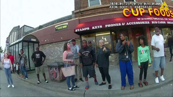 This image from a police body camera shows people gathering as former Minneapolis police officer Derek Chauvin was recorded pressing his knee on George Floyd's neck for several minutes.