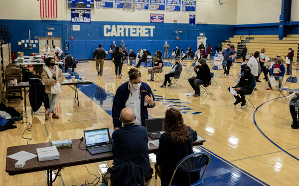 A mass vaccination event for teachers in Carteret, N.J., this month. About eight million school employees had received at least one vaccine dose by the end of March.