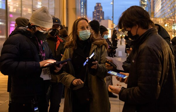 """A guest showed her """"Excelsior Pass,"""" which offers proof of vaccination, on a phone outside The Shed, a performing and visual arts venue in New York."""