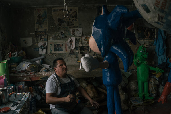 Ivan Mena Álvarez's piñata business has suffered during the pandemic.