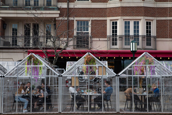 People dining outdoors at a restaurant in Birmingham, Mich., on Friday. Nine of the 10 hardest-hit metro areas in the country are currently in Michigan.