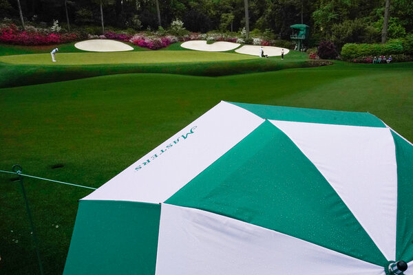 A 78-minute rain delay on Saturday slowed the greens down.