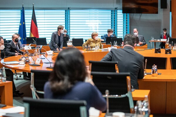 Chancellor Angela Merkel, center, at a cabinet meeting in Berlin on Tuesday. Her government's proposal on coronavirus restrictions would place half the country over the threshold for lockdown.