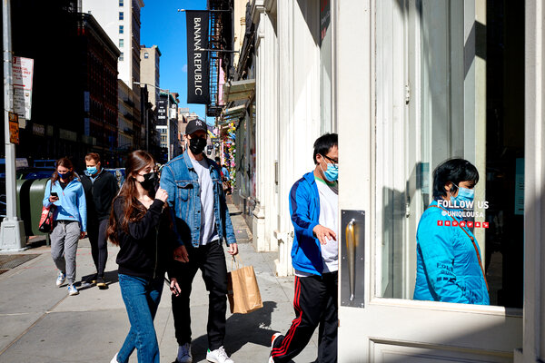 Shoppers in New York City on Tuesday. Retail sales surged last month, and the latest jobless claims report also provided fresh signs of economic revival.