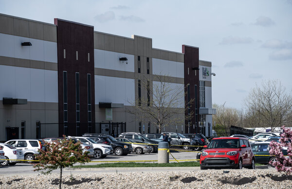 Police tape surrounded the parking lot of the FedEx facility where eight people were killed late Thursday. A FedEx spokesman said cellphone access was limited there to minimize distractions.