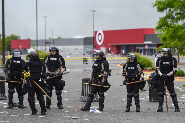 Members of the Minnesota State Patrol surrounding a Target store during protests over the death of George Floyd last May.