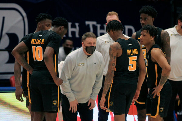 Virginia Commonwealth players with their coach, Mike Rhoades, at a game last month. The team was not able to play in its first-round game against Oregon on Saturday.