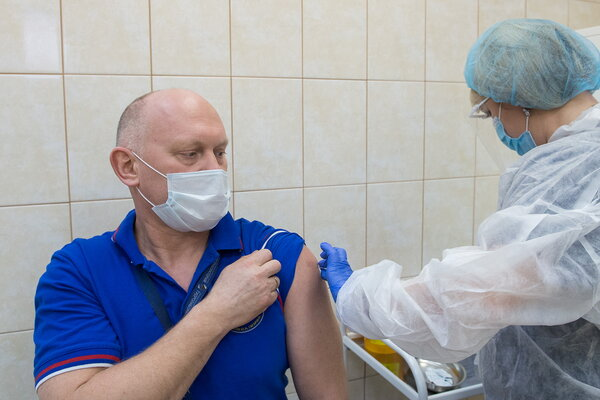 Oleg Artemyev, a Russian astronaut, was inoculated against Covid-19 with the Sputnik V vaccine in December.