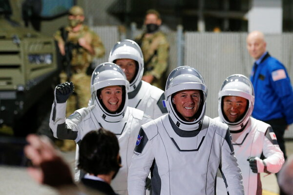 The four astronauts ahead of their departure to the launchpad on Friday.