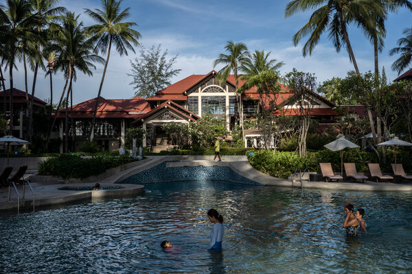 A small number of guests enjoying the pool at a resort in Phuket, Thailand, this month.