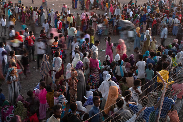 People who fled from the Tigray region of Ethiopia waiting in Sudan for supplies from the U.N. refugee agency.