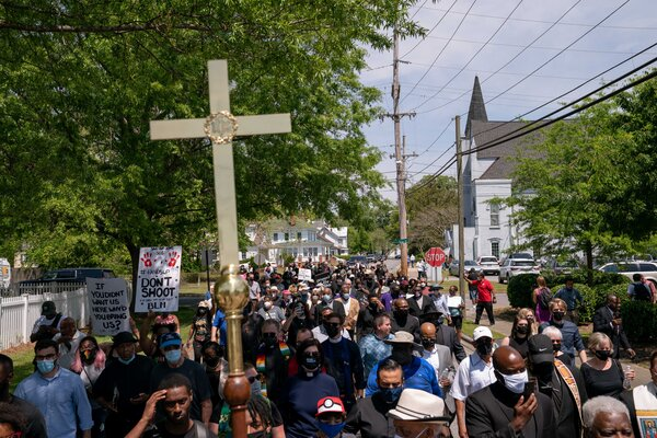 Faith leaders march from A.M.E. Zion Church to the scene where Andrew Brown Jr. was killed.