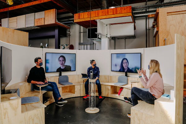 Google's new meeting rooms are designed to put virtual attendees on the same footing as in-person attendees.