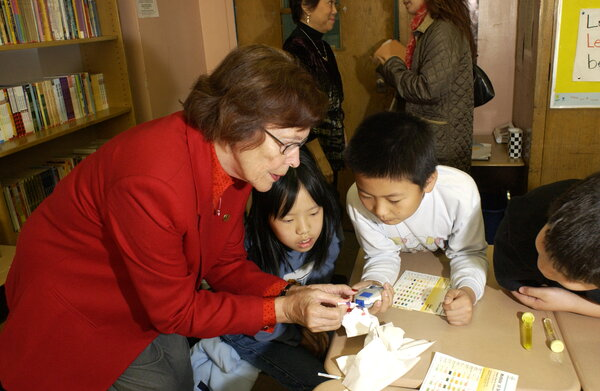 Ms. Free during the 2000s performing glucose-testing experiments with schoolchildren.
