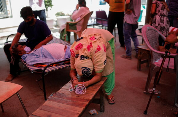 A woman pleaded for oxygen for her husband at a Sikh temple, in Ghaziabad, India, on Monday.