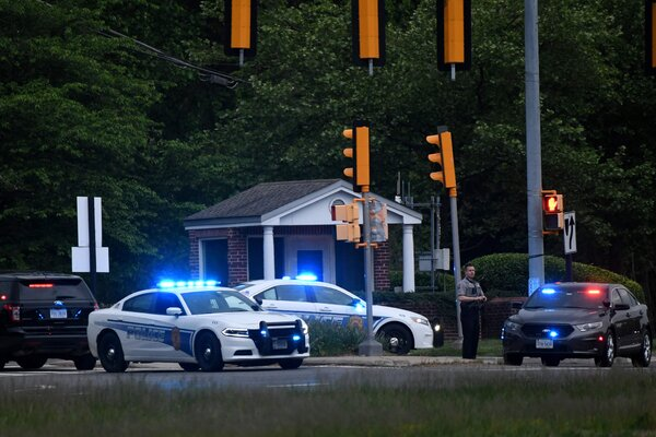 Police cars outside the C.I.A. headquarters after an intruder was shot by an F.B.I. agent on Monday in Langley, Va. The man died of his injuries, the F.B.I. said on Tuesday.