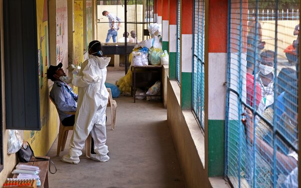 A health worker took a swab sample for a coronavirus test in Bangalore, India, on Monday.