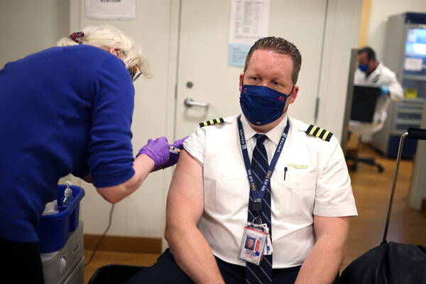 A United Airlines vaccine clinic at O'Hare Airport in Chicago. Employers are using on-site vaccinations to encourage workers to get shots.
