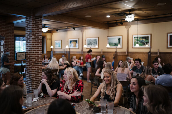 A restaurant in Columbia, Mo., on Saturday. Guidance from the Centers for Disease Control and Prevention advises even vaccinated people to continue to wear masks in indoor public spaces, including restaurants when they are not actively eating and drinking.