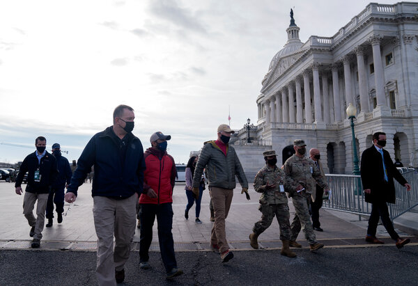 Former Acting Secretary of Defense Christopher Miller, center, met with members of the National Guard outside the Capitol on Jan 17.