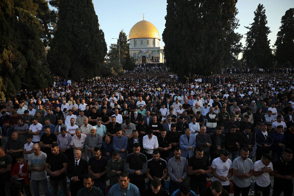 Palestinian Muslims performing Eid al-Fitr prayers in the Aqsa Mosque compound in the Old City of Jerusalem on Thursday.