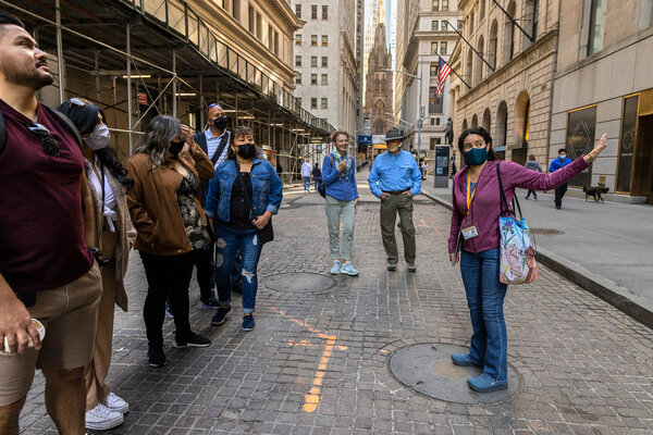 A tour group in Manhattan the day after the federal guidance changed mask guidance for vaccinated people. New York said Thursday it was reviewing the recommendations.