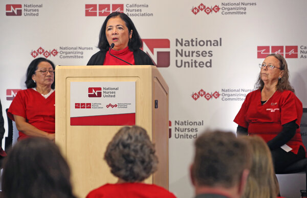 Bonnie Castillo, executive director of National Nurses United, last year in Oakland, Calif. Ms. Castillo is condemning the Centers for Disease Control and Prevention's lifting of mask recommendations for vaccinated people.