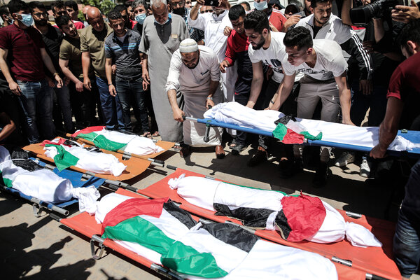 A funeral for people killed in an Israeli airstrike on the Shati refugee camp in the Gaza Strip.