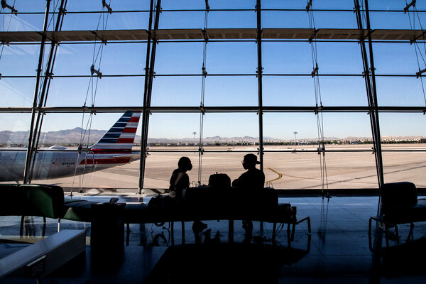 Travelers at McCarran International Airport in Las Vegas. Prices are rising on everything from airline tickets to used cars as the economy reopens.