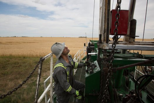 A worker prepared to shut down an oil well in Alberta, Canada, in 2020. To reach global climate goals, oil production must be reduced by 75 percent by 2050, the International Energy Agency said.