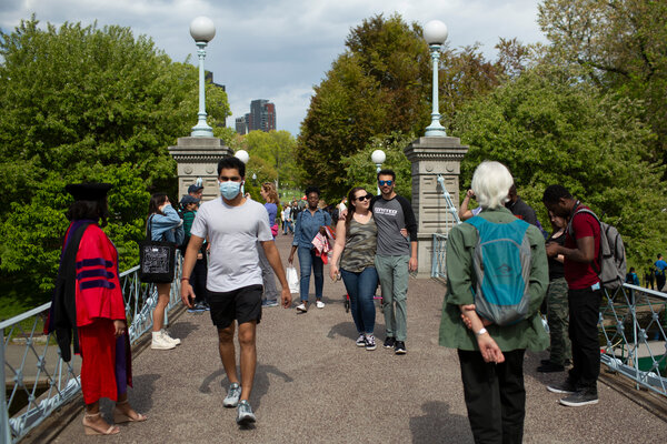 Last week in the Public Gardens in Boston, some people wore masks, others did not.